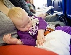 toddler girl sleeping on plane